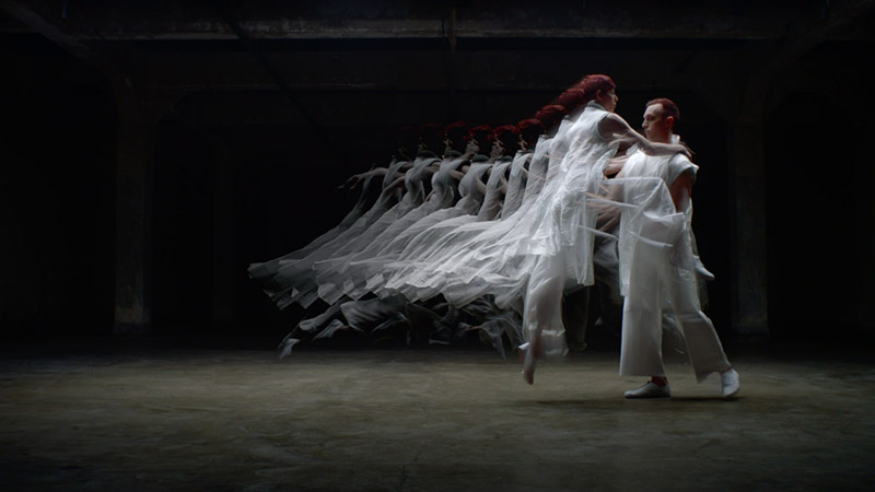 a woman jumps into a man's arms, and several translucent frames of her image behind her